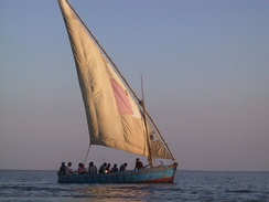 "Dhow with lateen sail in ""bad tack"" with the sail pressing against the mast, in Mozambique."