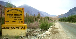 Jimmy Buffett quotation on Himank/BRO signboard in the Nubra Valley, Ladakh, Northern India