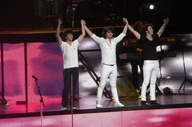 Jonas Brothers performing during their Look Me in the Eyes Tour.