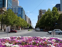 King William Street, one of the widest main streets in an Australian capital city, viewed from Victoria Square.