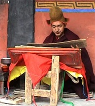 Buddhist monk Geshe Konchog Wangdu reads Mahayana sutras from an old woodblock copy of the Tibetan Kangyur