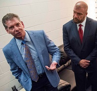"WWE chairman Vince McMahon (left) with son-in-law and NXT founder/executive director Paul ""Triple H"" Levesque"