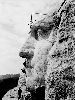 Construction on the George Washington portrait at Mount Rushmore, c. 1932