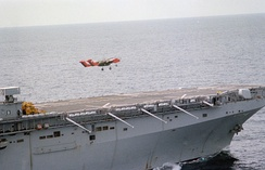 An OV-10A Bronco from VMO-1 takes off from the flight deck of USS Nassau in 1983