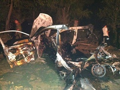 A car hit by a rocket shot by Hamas.