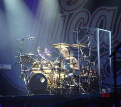 American rock and jazz drummer Tris Imboden using a clear perspex drum screen on stage.