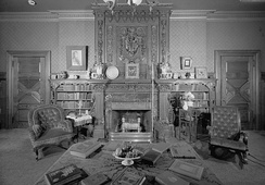 Library of Twain House, with hand-stenciled paneling, fireplaces from India, embossed wallpaper, and hand-carved mantel from Scotland