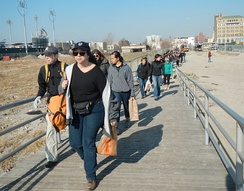 Volunteers arrive to clear the boardwalk after Hurricane Sandy.