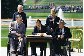 President Bush signs the Americans with Disabilities Act into law