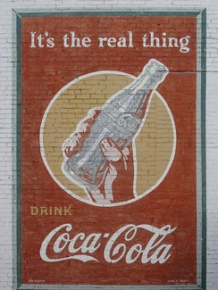 This refurbished Coca-Cola advertisement from 1943 is still displayed in Minden, Louisiana.