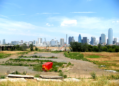 The beginning of work on the extension of Woodall Rodgers Freeway into West Dallas