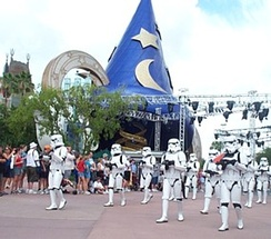 Imperial Stormtroopers parade near the Sorcerer's Hat during Star Wars Weekends.