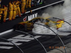 Logano celebrates winning the 2015 Irwin Tools Night Race.