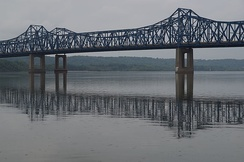 The twin steel truss bridges known as McClugage Bridge, spanning the Illinois River at Peoria
