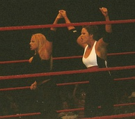 Stratus (left) along with Molly Holly during a WWE house show in October 2004