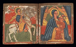 Ethiopian Orthodox wooden diptych of St. Mary and the infant Jesus with archangels above them. St. George appears on a white horse on the left. (Late 16th-early 17th century)