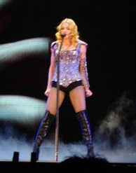 "Madonna during the performance of ""Frozen"". For this performance a video of a naked man and woman was used as the backdrop. This video was directed by Chris Cunningham, the director of the original music video."