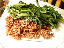 A plate of Wehani rice, with sauteed dandelion greens