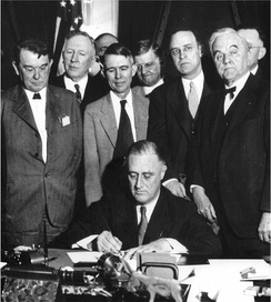 President Franklin D. Roosevelt signs the TVA Act
