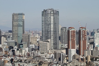 Roppongi Hills' buildings (center and right) and Tokyo Midtown Tower (left)