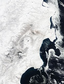 Views of Kamchatka from space in early summer (left) and late winter (right). Note the sea ice paralleling the coastline.