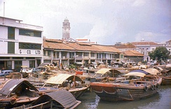 Singapore thrives as an entreport. Bumboats used to transport cargoes and supplies between nearshore ships and Singapore River, c.1960