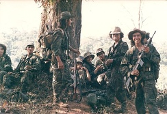 Members of ARDE Frente Sur taking a smoke break after routing the FSLN garrison at El Serrano in southeast Nicaragua in 1987