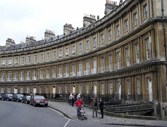 "Very grand terrace houses at The Circus, Bath (1754), with basement ""areas"" and a profusion of columns."