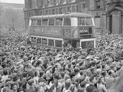 People gathered in Whitehall to hear Winston Churchill's victory speech and celebrate Victory in Europe, 8 May 1945
