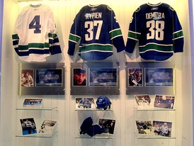 Following Rypien's death, the Canucks produced a display in the Rogers Arena concourse featuring his jersey, equipment and photos. (Also honoured in the display are Barry Wilkins (left) and Pavol Demitra (right), both of whom also died in the summer of 2011.)