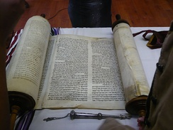 A Torah scroll and silver pointer (yad) used in reading.