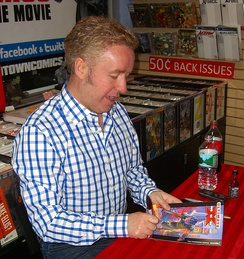Writer Mark Millar signing a copy of the first issue during an appearance at Midtown Comics in Manhattan.