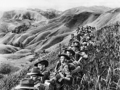 Australian soldiers resting in the Finisterre Ranges of New Guinea while en route to the front line