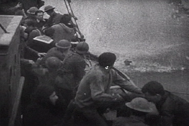 Feature film re-enactment of a British fishing boat picking up troops off the coast of Dunkirk.