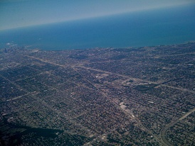 Airborne view of the dense southern part of Chicago, running alongside Lake Michigan. Downtown Chicago is at the far left by the lake in the photo.