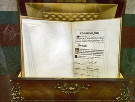 A copy of the Spanish Constitution, signed by King Juan Carlos, is held at the Palace of the Cortes.