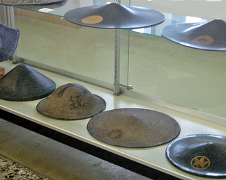 This display case at Gifu Castle shows many kasa of the type known as jingasa.