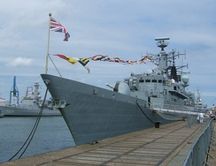 "HMS Cornwall, ""dressed"" on the occasion of her official visit to the port of Zeebrugge, Belgium, in 2006, and flying the Union Jack from the jackstaff."