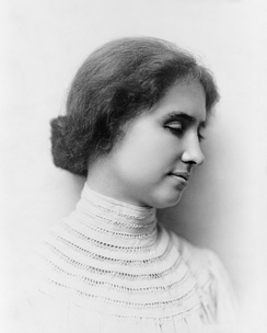 "Helen Keller portrait, 1904. Due to a protruding left eye, Keller was usually photographed in profile. Both her eyes were replaced in adulthood with glass replicas for ""medical and cosmetic reasons"".[33]"