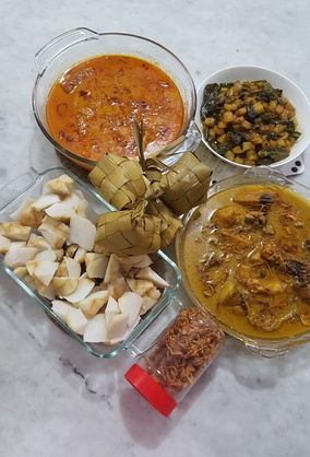 Opor ayam (curry style), gulai, ketupat, diced potatoes with spices, and bawang goreng served during Lebaran (Eid al-Fitr) in Indonesia
