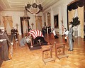 The remains of John F. Kennedy lying in repose in the East Room of the White House on November 23, 1963.