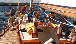 A young John Kerry (in white) aboard the yacht of John F. Kennedy, in 1962