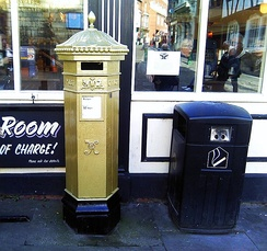 The Gold Victorian-style Penfold post box in Lincoln painted in recognition of Paralympian Sophie Wells who won the gold medal in the team Equestrian event at the 2012 Paralympic Games in London. It is the only post box painted gold in the county