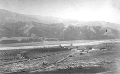Aerial view of the rancho in the Santa Clara River Valley in 1888, with vineyards on the left and the Santa Clara River in the background.