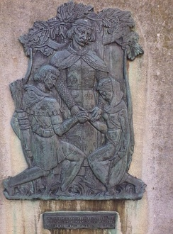King Richard the Lionheart marrying Robin Hood and Maid Marian on a plaque outside Nottingham Castle