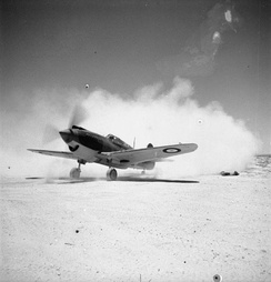 A Curtiss Tomahawk Mark IIB of No. 250 Squadron RAF raises the dust at Sidi Haneish Airfield, before taking off on a patrol.