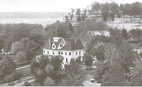 "Ferdinand Walther constructed the Starved Rock Hotel, seen here c. 1905. The ""rock"" is the bluff in the upper right."