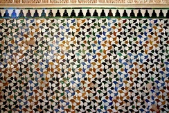 Elaborate and colourful zellige tessellations of glazed tiles at the Alhambra in Spain