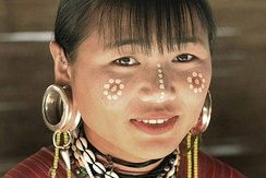 A Karen woman from Burma with traditional ear plugs