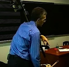 "Manhattan School of Music professor Timothy Cobb teaching a bass lesson in the late 2000s. His bass has a low C extension with a metal ""machine"" with buttons for playing the pitches on the extension."